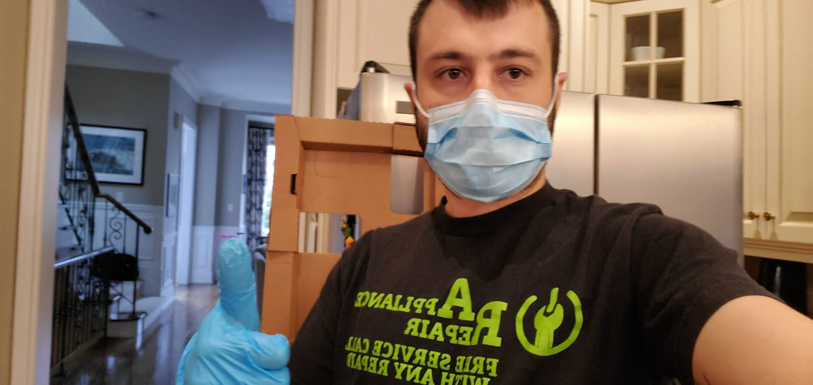 Our Technician staining safe with mask and gloves
